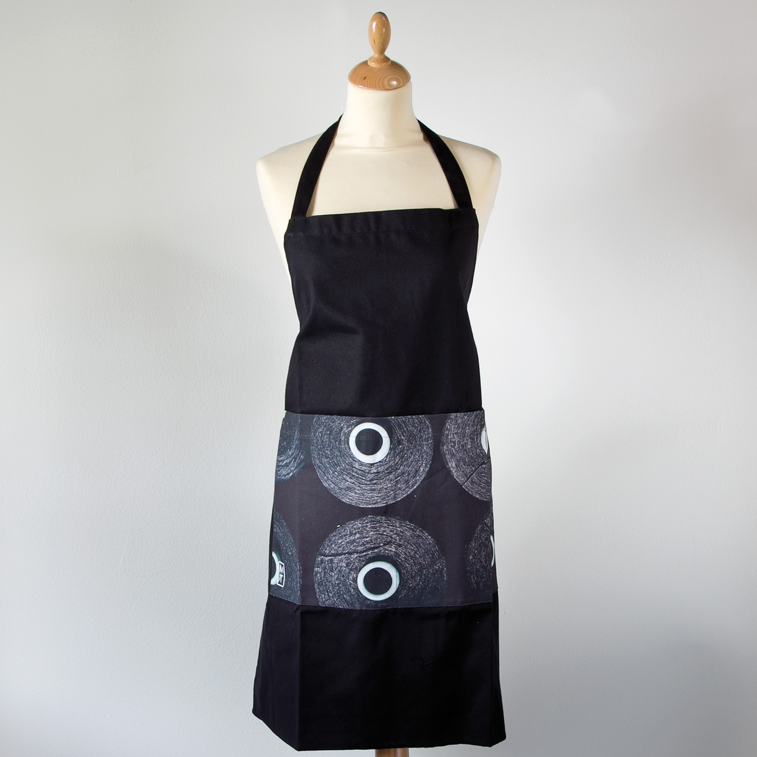 Apron with cones of black yarn