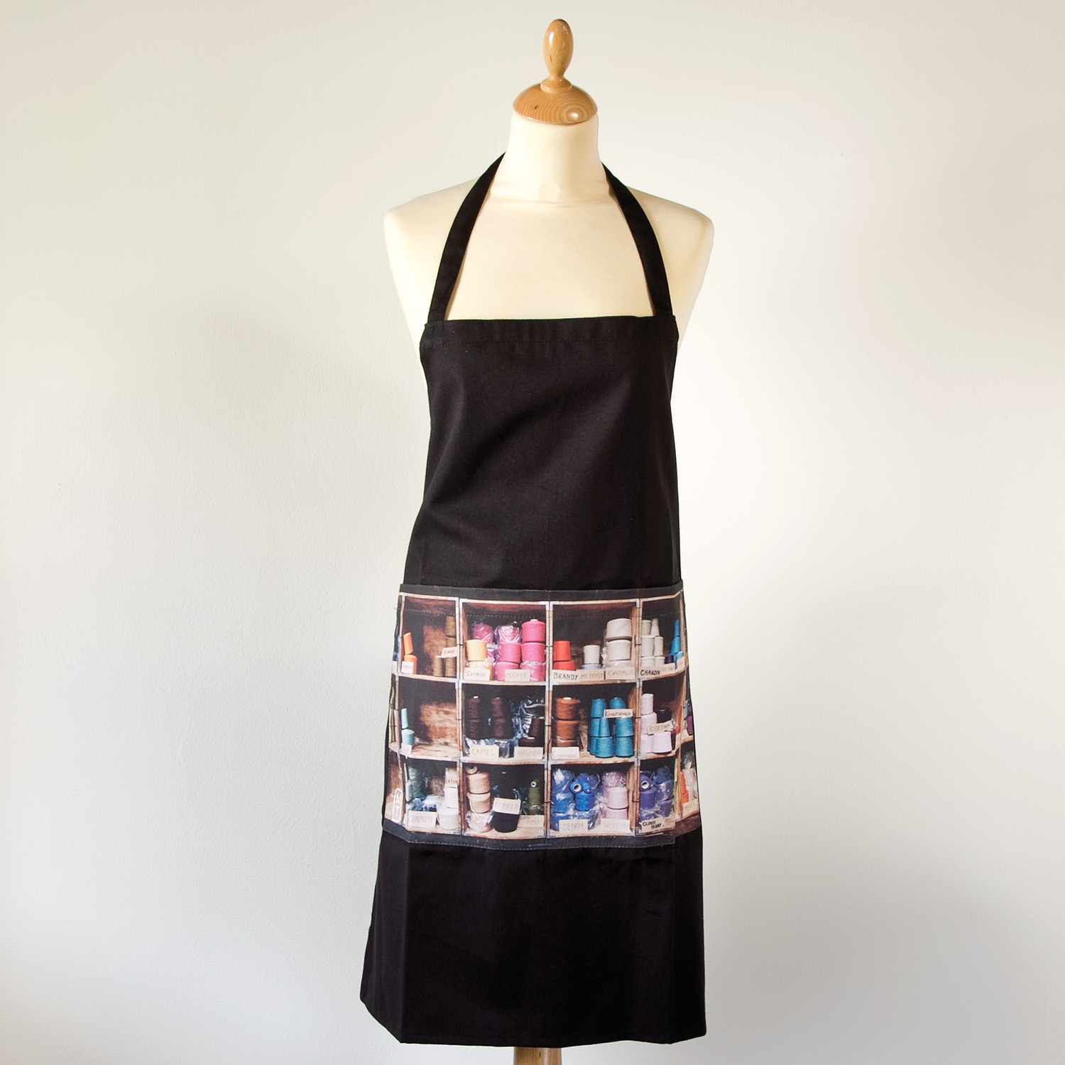 Apron with yarn store image